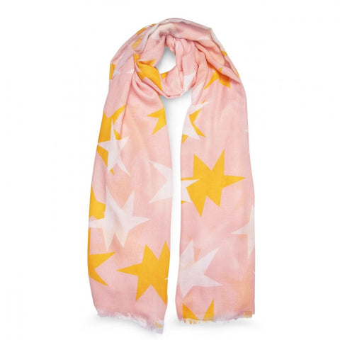 This gorgeous blush pink scarf featuring large bright stars and soft frayed edges is a vibrant addition to your everyday wardrobe.