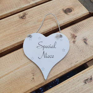 Hanging wooden heart - hand painted with the printed slogan:  'Special Niece'