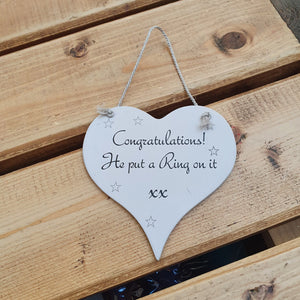 Hanging wooden heart - hand painted with the printed slogan:  'Congratulations! He put a ring on it.'