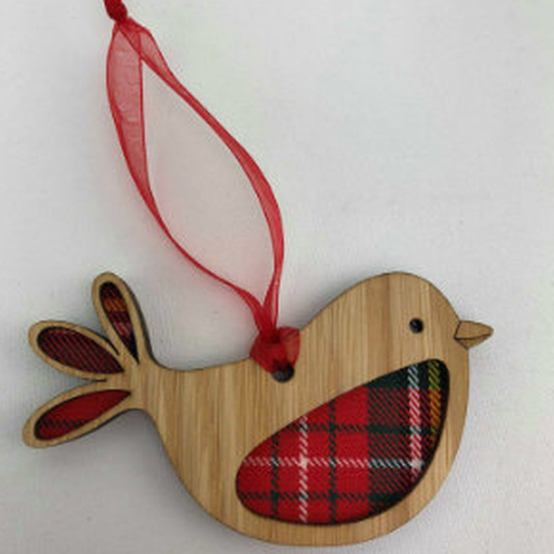 A unique keepsake Christmas decoration with a Scottish twist.  A wooden Robin with tartan inserts, mounted on card and packaged in clear cellophane packets.