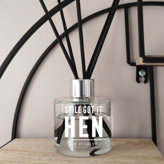 This beautiful scented reed diffuser features the sentiment 'Still Got It Hen' and comes presented in its own gift box.