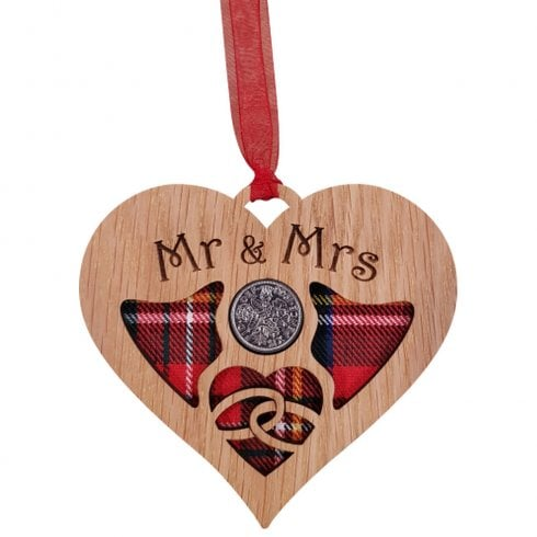 A unique keepsake gift with a Scottish twist.  The sixpence is mounted onto hanging oak veneered wooden heart with tartan inserts, mounted on card and packaged in clear cellophane packets.  The sentiment 'Mr & Mrs' is engraved across the heart.