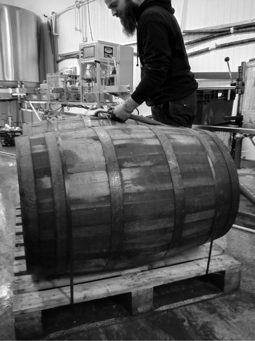 Head Brewer Joe Thomson filling whisky barrels with Imperial Stout