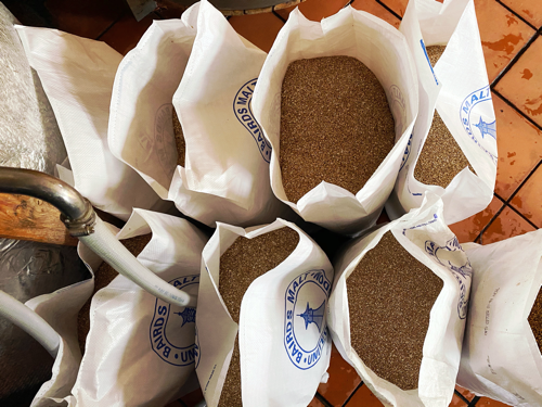 Opened bags of malt