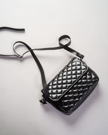 junya watanable quilted crossbody bag in black synthetic leather resin noodle stories