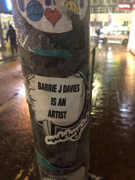 Limited edition street art sticker by the artist Barrie J Davies. 5cm x 5cm - you can stick it to stuff. Barrie J Davies is an Artist - Pop Art and Street art inspired Artist based in Brighton England UK - Pop Art Paintings, Street Art Prints & Editions available.