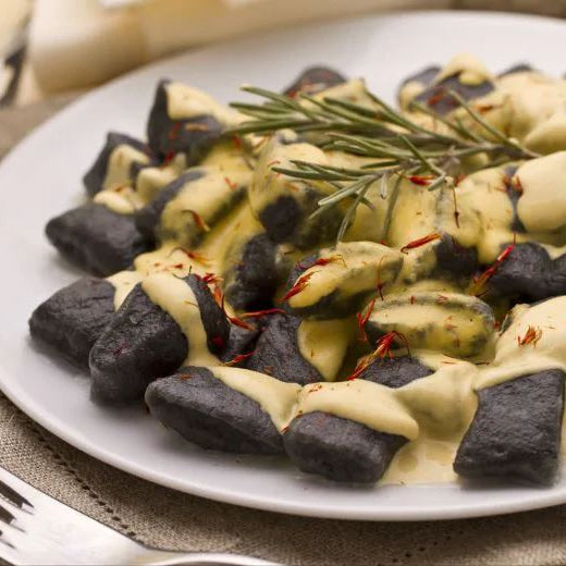 Black Squid Ink Gnocchi with Sea Bass Sauce and Saffron