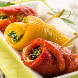 Rolls of marinated pepper and strawberry