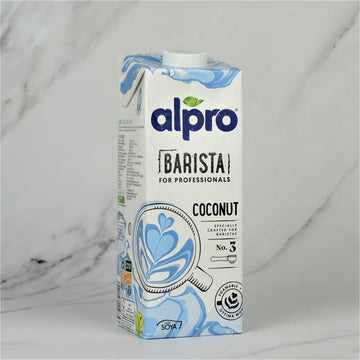 1 Litre carton of Alpro Barista for professionals Coconut Milk Drink on a white marble background