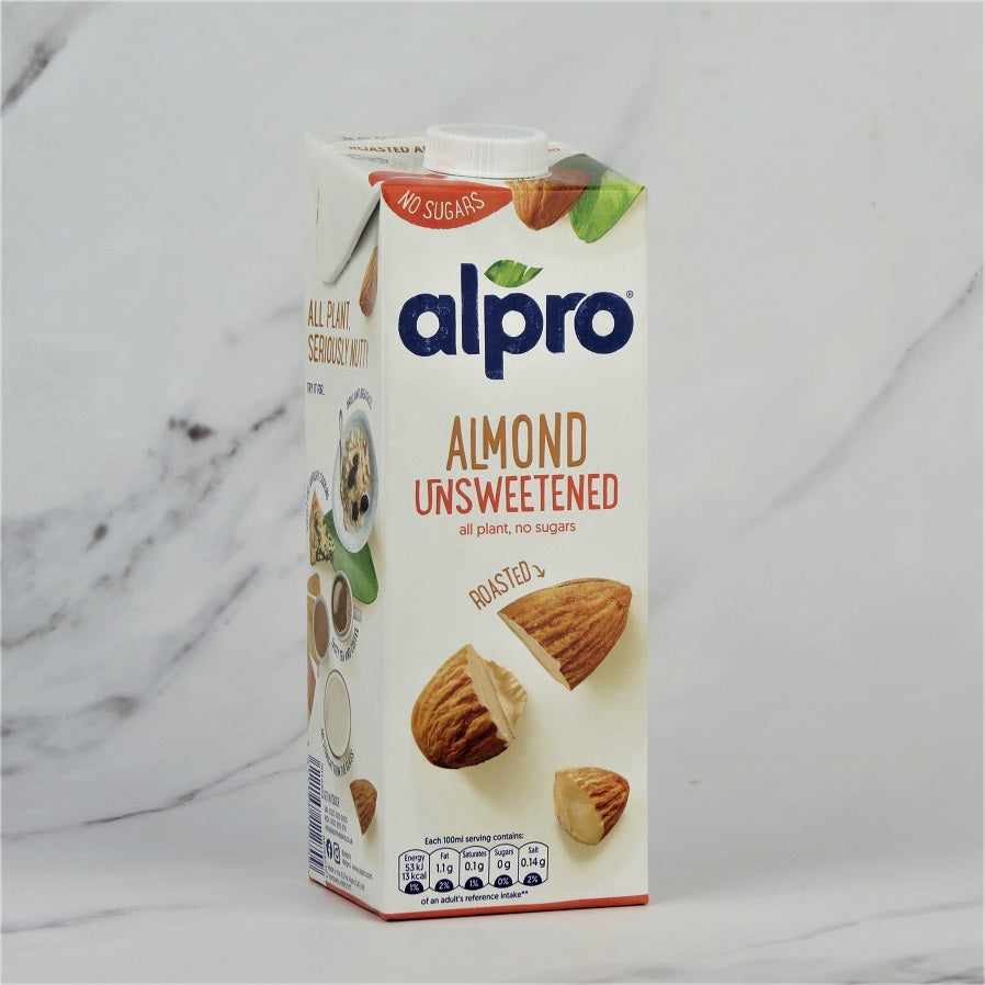 1 Litre Carton of Alpro Almond Unsweetened Milk on a white marble background