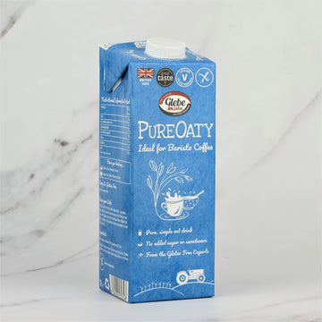 1 Litre carton of Glebe Farm PureOaty Milk Drink on a white marble background