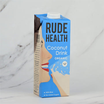 1 Litre carton of Rude Health Organic Coconut Milk Drink on a white marble background