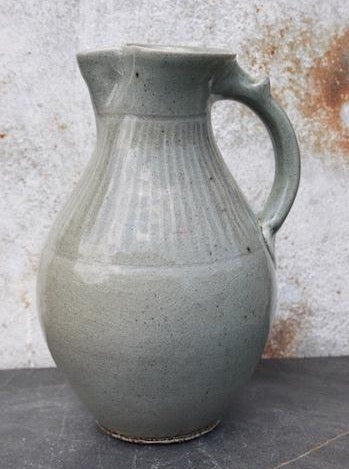 Half gallon pitcher, incised vertical lines under celadon blue glaze