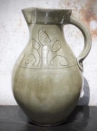 Half gallon pitcher, with incised floral motif under celadon green glaze