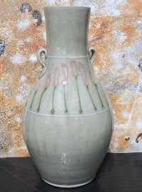 Lovely vase with lug handles and pale celadon green with a lively darker green and dark pink floral motif.