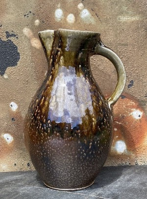 "Pitcher with plain salt glaze with wood ash runs with a ""103"" medallion on it's chest"