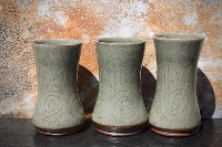 Three tumblers with celadon green glaze and incised decoration.