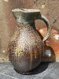 Pitcher with looping swags and a pale glaze on the neck