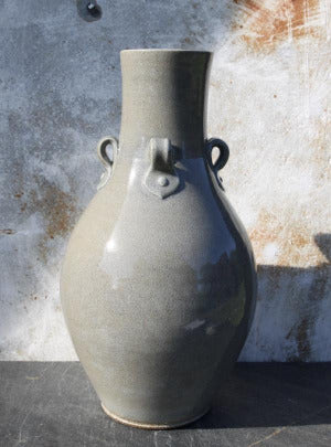 Two gallon vase with 4 lugs handles and blue celadon glaze. Grand!