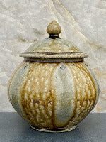 Mark Hewitt Pottery jar with golden ash glaze and blue glass runs