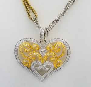 18Kt. Two Tone diamond Heart pendant on 14 Kt chain