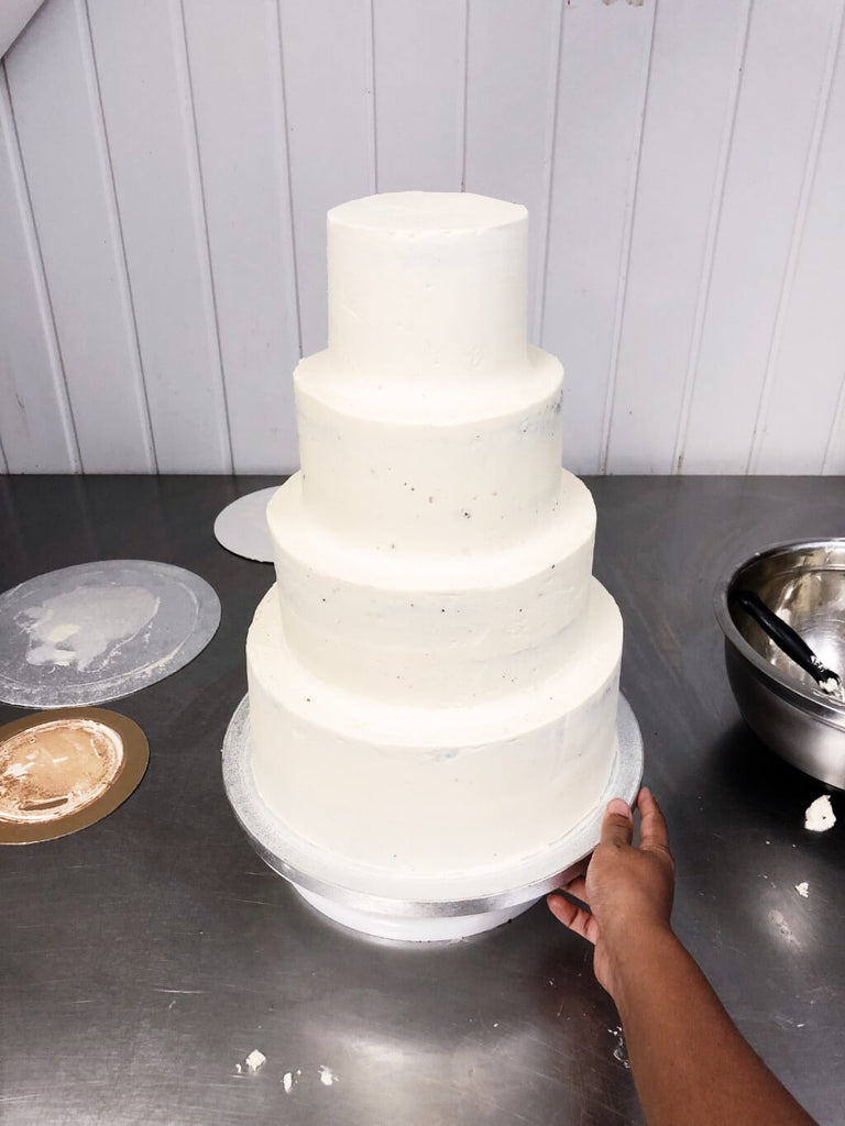 Perfectly stacked and smoothed tiered cake
