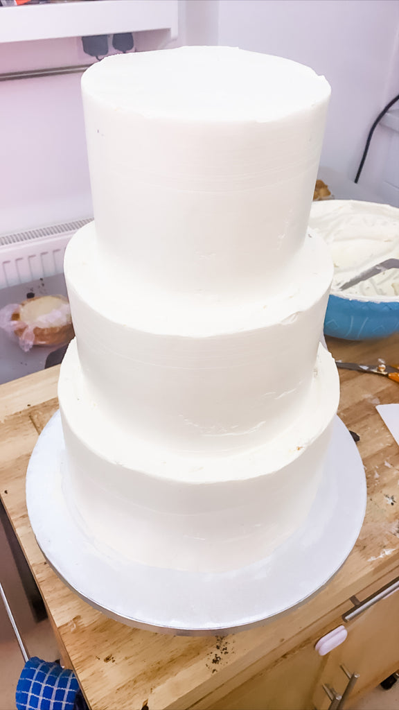 Plain white three tiered cake