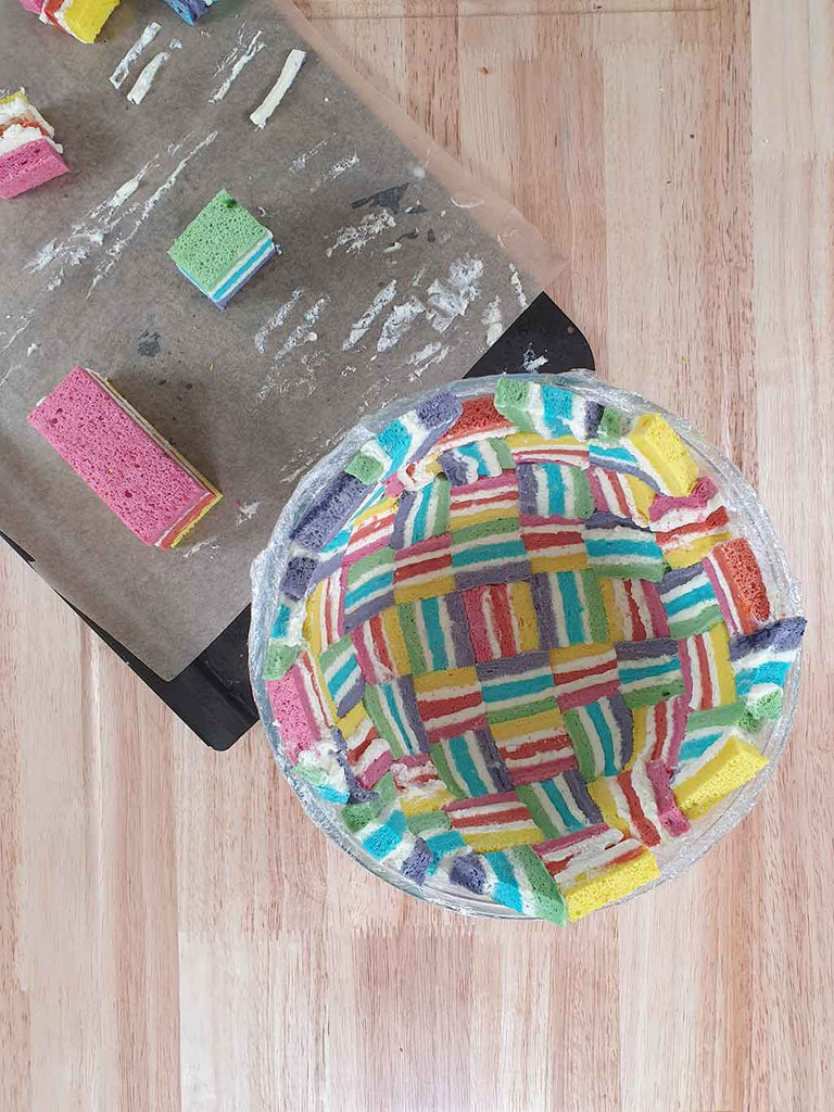 Rainbow Charlotte Royale Recipe - sponge lined mould
