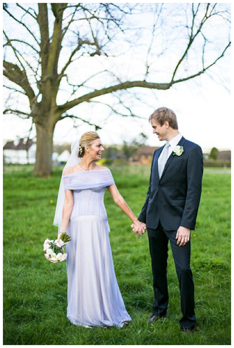 Beautiful Bride in a Blue Dress and her Dashing Groom