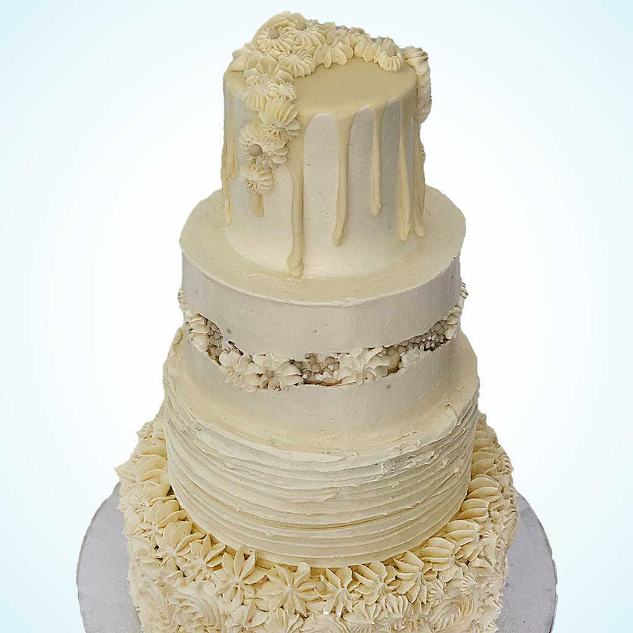 Four-Tiered Buttercream Dream Wedding Cake