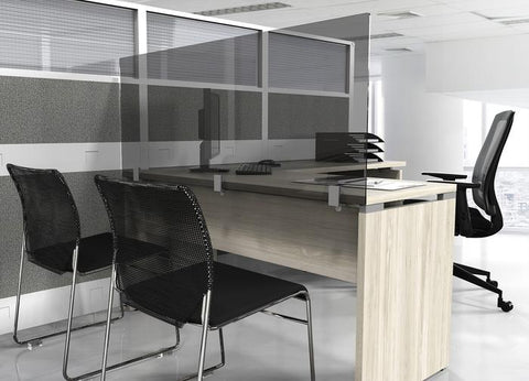 2 chairs facing an L-shape desk with a glass partition mounted to the surface