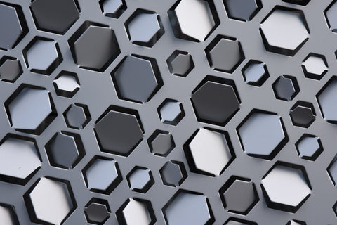 grayscale hexagons cut out of paper