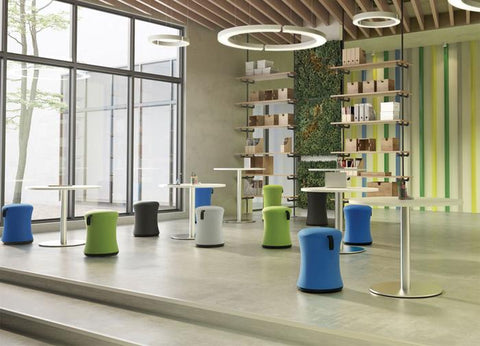 Ergo stools at small tables in modern space