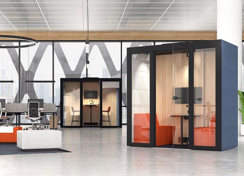 2 4-person sound proof booths in an open concept office space