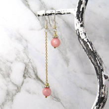 Load image into Gallery viewer, Pink Quartz Asymetric sterling silver earrings in Jewellery bottle.