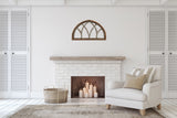 Half moon window over brick fireplace in farmhouse style living area.