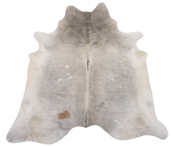 Very light gray cowhide rug with brown spot.