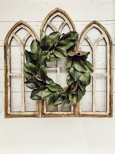 Rustic Cathedral Wall Arches, two medium and one large with a 17 inch magnolia wreath in the middle.