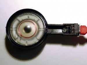 The flexure creasing is easily seen in the diaphragm to the left; connector and springs can be seen at right.
