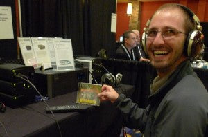 "Mario gets a kick out of our bass demo disc, ""Beat Dominator."""