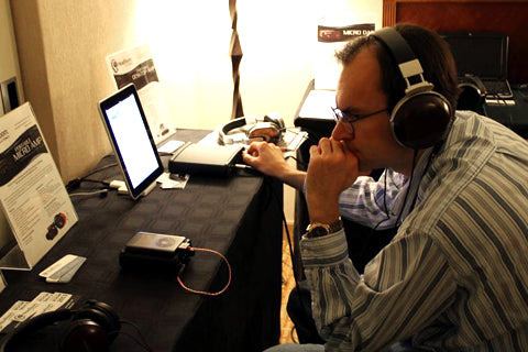 An attendee listening to Denon D-7000
