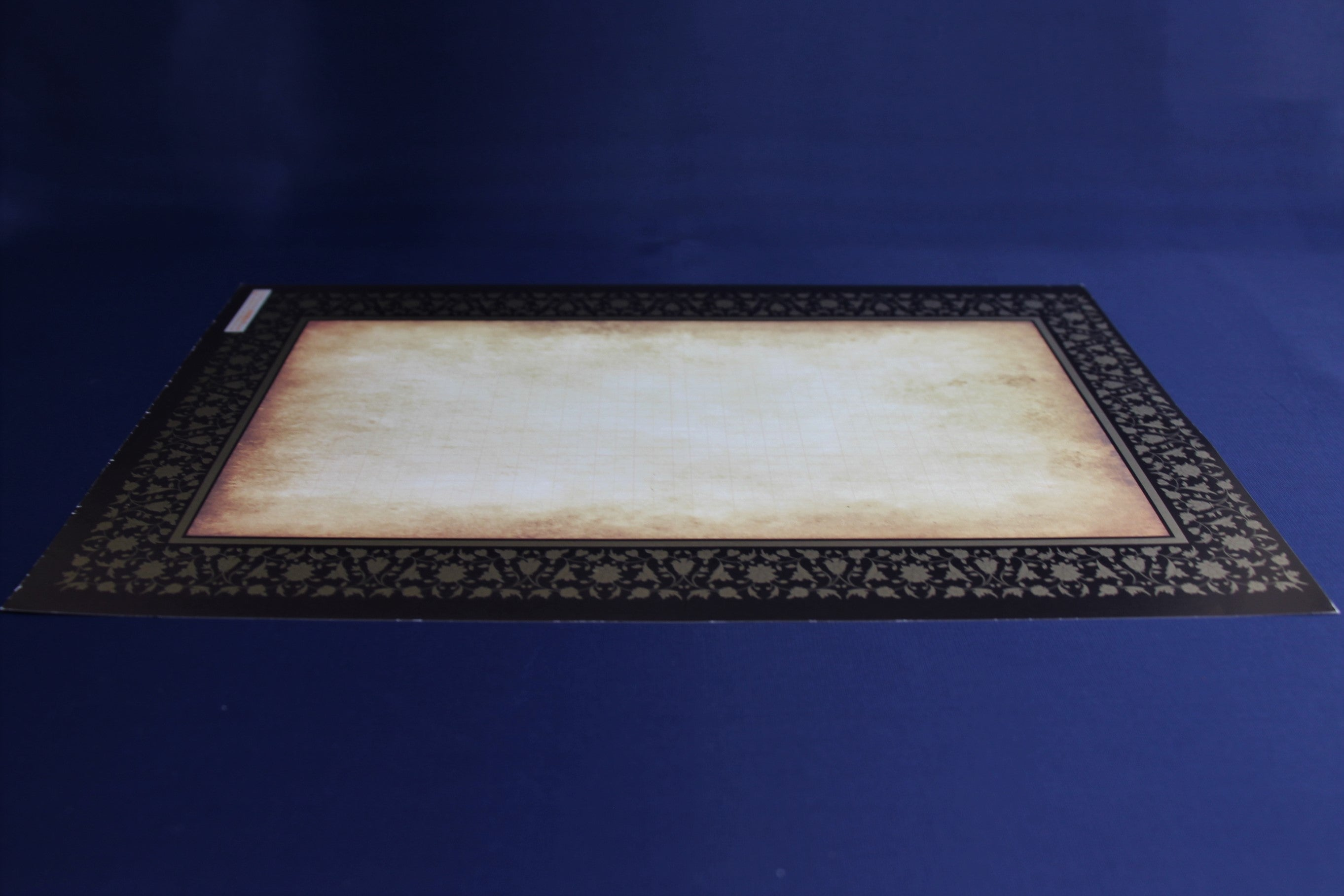 12 sheets of semigloss paper with black and gold decorated border