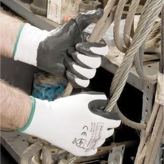 Cut-resistant gloves being used to work with rope