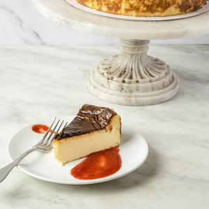 Slice of Classic Mascarpone Cheesecake with Strawberry Jam dessert or pastry
