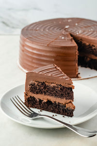 Slice of Salted Chocolate Cake with Caramel dessert or pastry