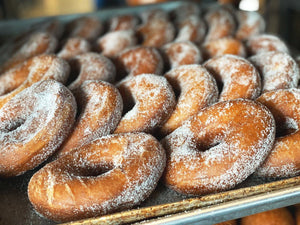 Tray of Old Fashioned Donuts topped with Sugar dessert or pastry