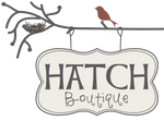 Bird & nest sitting atop the Hatch Boutique sign