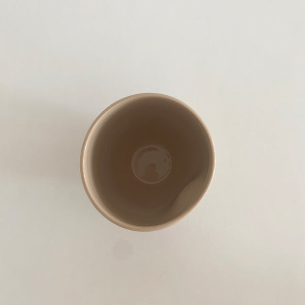 Small porcelain thumb cup