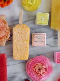 pink and yellow popsicle styling with ring boxes