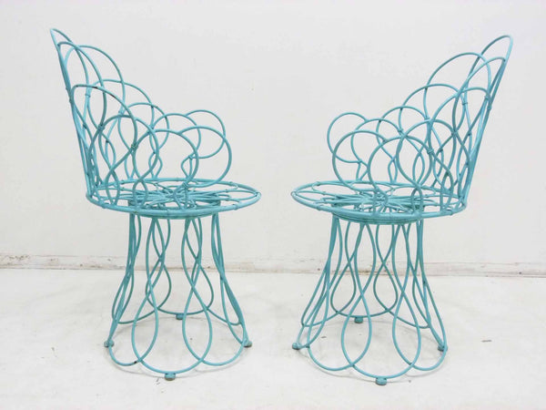 Art Deco-style wrought iron blue round patio chairs 2